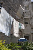 Clothesline between stone houses Royalty Free Stock Photos