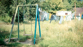 Clothesline and swing Royalty Free Stock Image