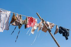 Clothesline with traditional Dutch clothes drying Stock Photography