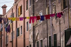 Clothesline in Venice with multi-coloured clothing royalty free stock images