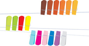 Clothespin. Colorful clothes-pegs/clothespins hanging on string Stock Image