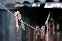 Clothespin. Old Wooden clothespin on a clothesline Royalty Free Stock Images