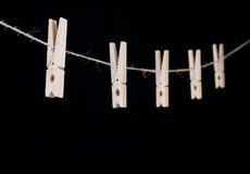 Clothespin aislado en fondo negro Fotos de archivo