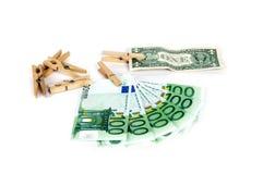 Clothespin and bonds. Euro dollar royalty free stock photos