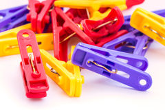 Clothespin clips on isolated white background Stock Photos