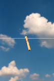 Clothespin. Clothespin on clothesline against blue sky Royalty Free Stock Photography