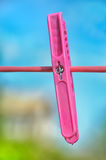 Clothespin on clothesline. A clothes pink rose on a wire Royalty Free Stock Photo