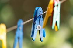 Clothespin on a clothesline. In the park in nature Royalty Free Stock Photos