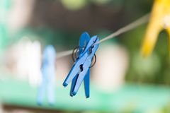 Clothespin on a clothesline. In the park in nature Royalty Free Stock Image