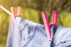 Clothespin on clothesline keeps clothes on. Copy space background Stock Photography