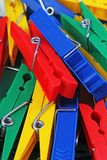 Clothespin clothespins as background. Colorful forecaps tweezers clips as background. Rainbow colors. Forecap tweezer Stock Image