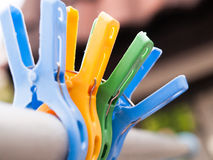 Clothespin colorful. Clothespin brilliant. A variety of colors blue, yellow, green, blue on a clothes line Stock Photos