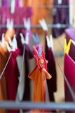 Clothespin and Colorful clothes Royalty Free Stock Images