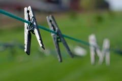 Clothespin en línea Foto de archivo libre de regalías