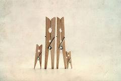Clothespin Family: Man, woman with children. Success family concept Royalty Free Stock Photography