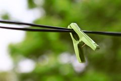 Clothespin. The green clothespin to waiting Stock Photography