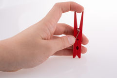 Clothespin in hand Royalty Free Stock Photos
