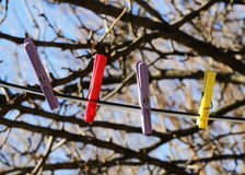 Clothespin hanging on rope, winter time Stock Image