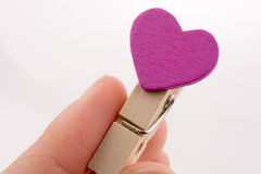 Clothespin with a heartshape in hand Royalty Free Stock Photography