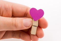 Clothespin with a heartshape in hand Stock Photography