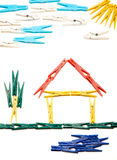 Clothespin house. House and surrounding outline made from colored clothes pegs, like children's drawings royalty free stock photo