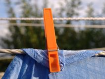 Clothespin and  laundry Royalty Free Stock Images