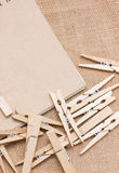 Clothespin With Notebook On Sackcloth. Royalty Free Stock Images