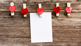 Clothespin red heart with paper white. Stock Photo