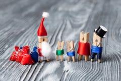 Clothespin Santas and family. xmas party invitation card template Royalty Free Stock Photos