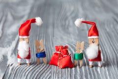 Clothespin Santas and kids Stock Image