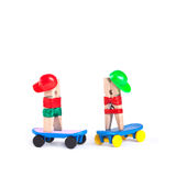 Clothespin skateboarders in a baseball caps.  Man and woman on  blue skate boards. white background, copy space Stock Photo