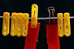 Clothespin and Small binder clip Stock Image