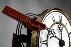 Clothespin stop the clock. Red Clothespin. Pinned to the Old Clock and stopping time Stock Images