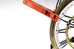 Clothespin stop the clock. Stock Photos