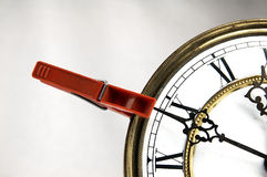 Clothespin stop the clock. Royalty Free Stock Images