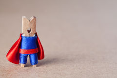 Clothespin superhero man against retro paper background. copy space Stock Image