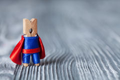 Clothespin superhero. Super hero funny man. wood background. copy space Stock Photography