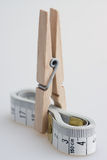 Clothespin and tape measure Royalty Free Stock Image