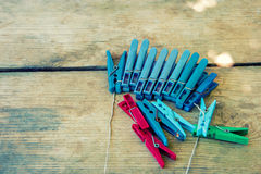 Clothespin on wooden background Royalty Free Stock Images