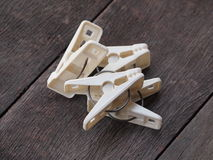 Clothespin on the wooden planks Stock Image