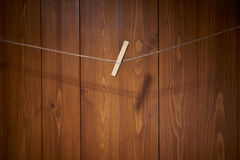 Clothespin on wooden wall Royalty Free Stock Image