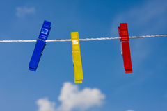 Clothespins. On blue sky background Stock Photo