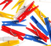 Clothespins. Some clothespins multi-colored on white isolated Stock Photos