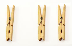 Clothespins. Three wooden clothespins on a white background Royalty Free Stock Image
