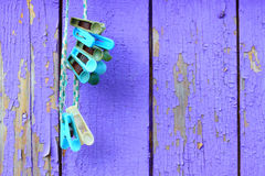 Clothespins against a wooden wall. Royalty Free Stock Photo