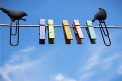 Clothespins on a background of blue sky Stock Photos