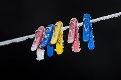 Clothespins on the balcony in the winter. In hoarfrost royalty free stock image