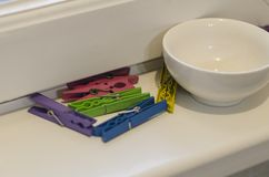 Clothespins and a bowl stock image
