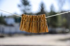 Clothespins for clothes and clothes hang against the blue sky on a Sunny day on a narrow royalty free stock photo