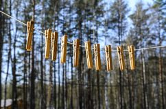 Clothespins for clothes and clothes hang against the blue sky on a Sunny day on a narrow royalty free stock photography
